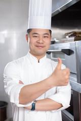 young man chelf in modern kitchen
