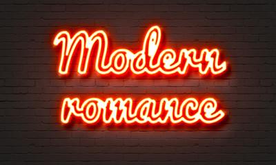 Modern romance neon sign on brick wall background.