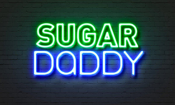 Sugar daddy neon sign on brick wall background.