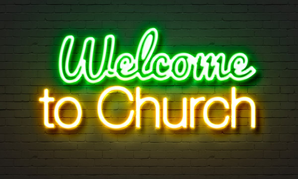 Welcome to Church neon sign on brick wall background.