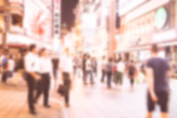 Blurred image of people shopping with vintage color effected