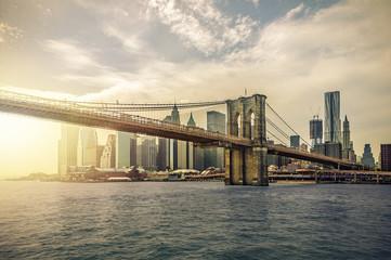 Manhattan Skyline with Brooklyn Bridge, New York City, USA, with lens flare