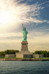 Statue of Liberty on Liberty Island with lens flare, New York City, USA