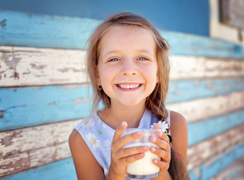 little girl is drinking milk