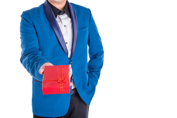 A man in suit giving red present box over white background