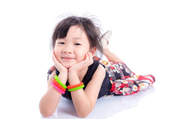 Little cute girl lying on the floor over white background