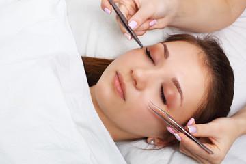 Eyelash Extension Procedure. Woman Eye with Long Eyelashes. Lashes, close up, selectve focus.