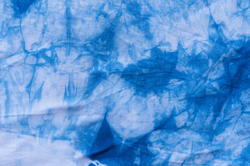Pattern of blue tie batik dye on cotton cloth, Dyed indigo fabric background and textured