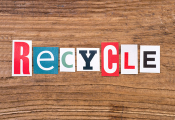 "Word ""recycle"" in cut out magazine letters on wooden background"