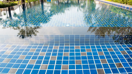 Closeup surface of the water in the swimming pool.
