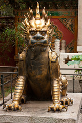 Statue of the mythical Qilin, a symbol of luck,  prosperity, and success, in the Imperial Palace, Beijing, China