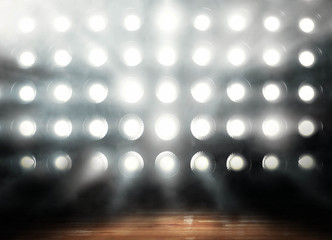 Professional basketball parquet in lights background render