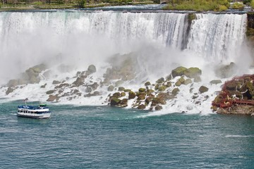 Beautiful picture with a ship and amazing Niagara waterfall