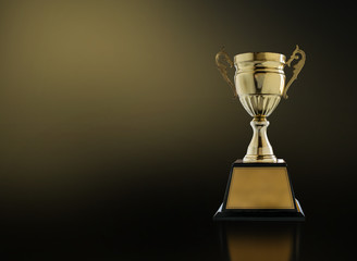 Champion Golden Trophy On Modern Black Background With Gold Light Copy Space Ready For Your Design