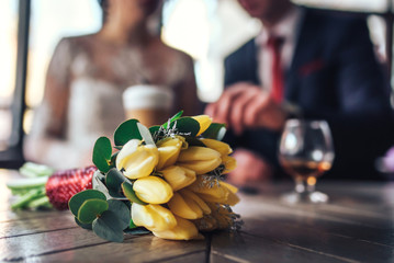 Young wedding couple relaxing together in cafe