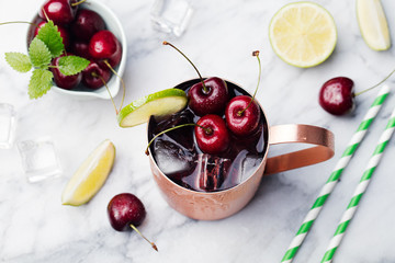 Cold cherry Moscow Mule cocktail Marble background