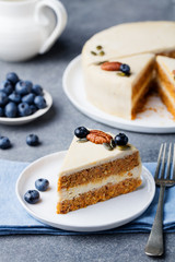 Vegan, raw carrot cake. Healthy food. Grey stone background