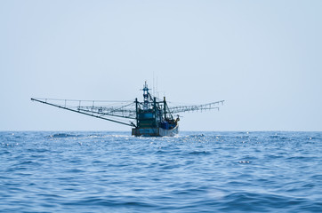 blue Fishing trawler on the ocean water