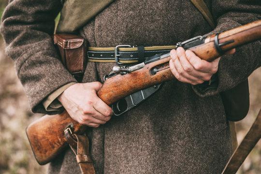Russian Soviet Infantry Soldier Of World War II Holds Rifle Weap
