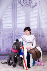 Attractive girl posing in the studio with puppies of breed Mastiff Neapolitana.