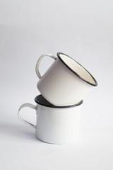 White enamel mugs