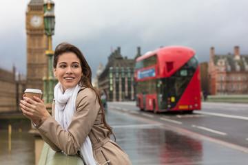 Foto op Aluminium Londen rode bus Woman Drinking Coffee on Westminster Bridge, Big Ben, London, England