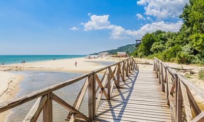 Wooden footbridge over the river. Black Sea Coast,  seaside resort Albena, Bulgaria Wall mural