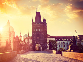 Wall Murals Prague Charles bridge tower in Prague on sunrise