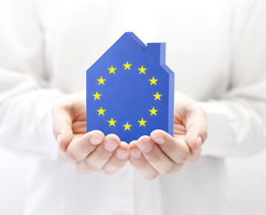 House with European Union flag in hands - fototapety na wymiar