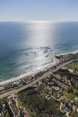 Aerial view of beach front homes and estates in Malibu, California.