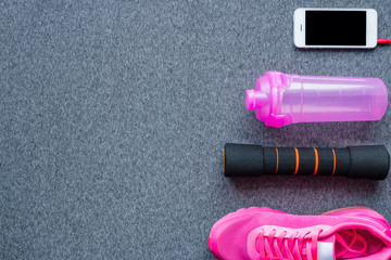 items for fitness training on a gray background and place for text