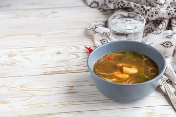 Simple Thai soup with shrimp, lemongrass, chilli and noodles