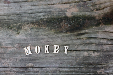 Money words or character, text on wood background