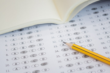 A pencil sitting on a test bubble sheet, optical form of an examination,Answer sheet with pencil