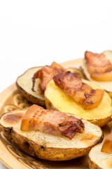Baked potatoes with skin and bacon on it
