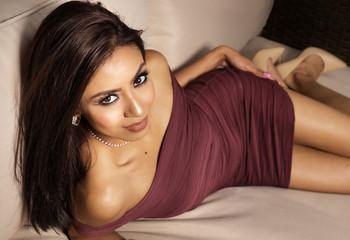 Beautiful elegant woman in burgundy dress