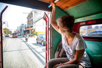 woman tourist traveling to the Thai public transport, Songteo