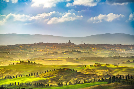 Siena city skyline, countryside and rolling hills. Tuscany, Italy