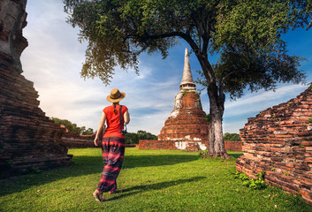 Tourist near ancient temple in Thailand
