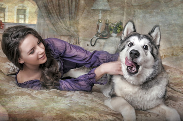 Girl plays with malamute