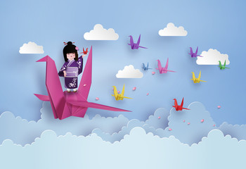 Japanese girls wearing national dress  and origami bird flying on the sky with cloud.