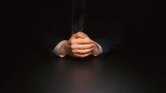 Businessman hands in a dark room