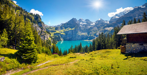Colorful summer morning on unique lake - Oeschinen (Oeschinensee)