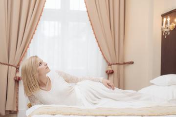 Bride in elegant hotel room