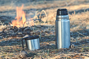 Thermos bottle with coffee or tea outdoor