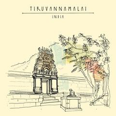 Tiruvannamalai, India. Arunachala mountain, small Hindu temple, cow statue