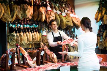 Female customer buying Spanish jamon