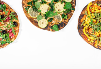 Different vegetarian pizza on white background with copy space