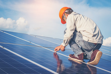 electrician working on installing solar panel in solar power plant