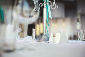 Wedding Banquet in the restaurant, the Tiffany color. Table. Chair. Arch. Tent. Tinsel.